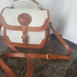 Dooney & Bourke white 100 % genuine leather purse